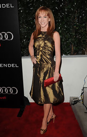 Kathy Griffin is a bronzed beauty in a drop waist cocktail dress and leopard print sling-backs.