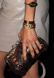 Zoe Saldana added more gleam to her look with a gold bangle which featured sculpted lips.