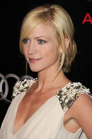 Brittany Snow balanced her plunging neckline with a low hanging chignon. She framed her face with side swept bangs.