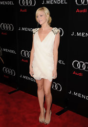 Brittany Snow paired an angelic white frock with nude peep toes. The heels featured metallic accents.