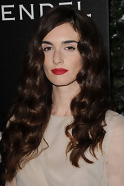 Paz Vega paired her elegant curls with bright red lips.