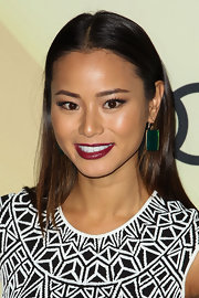 A deep berry lip color complemented her olive skin tone and gave her a glowing beauty look.