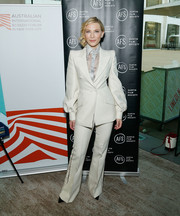 Cate Blanchett looked perfectly polished in a white pantsuit and pale blue blouse by Fendi Couture at the 'Where'd You Go, Bernadette' private dinner.
