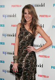 Laura Dundovic's zippered black patent leather clutch by Jimmy Choo added a rocker-chic feel to her ensemble at the live final of 'Australia's Next Top Model.