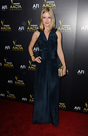 Pippa Black wore a navy silk gown with a ruffled bodice for the AACTA Awards.