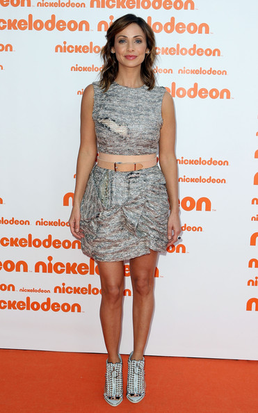 Natalie paired her silver metallic dress with studded peep toe ankle boots.