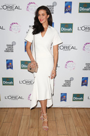 Megan Gale styled her outfit with chic nude strappy sandals.