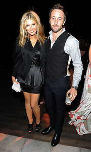 Delta Goodrem layered a stylish black blazer over a peplum LBD for her 2010 Breakthrough Awards look.