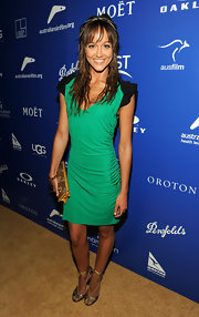 Sharni worked a green and black cocktail dress with gold accessories for the Australian Breakthrough Awards.