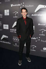 Kodi Smit-McPhee, at the Australians in Film's 2011 Breakthrough Awards, complemented his outfit with a pair of black slip-on sneakers featuring a white star print.