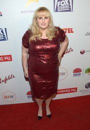 Rebel Wilson shimmered in a form-fitting red sequin dress at the Australians in Film Awards.