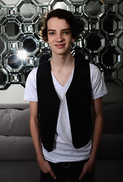 Kodi Smit-McPhee wore an unbuttoned V-neck vest over a white V-neck T-shirt to the Australians in Film Awards & Benefit Dinner.