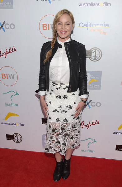 A black leather jacket finished off Abbie Cornish's look in edgy style.
