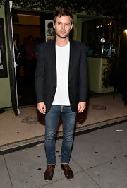 Oliver Ackland chose a notch-lapel black blazer to dress up his basic tee.