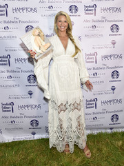 Christie Brinkley looked simply divine in this white lace-panel maxi dress at the East Hampton Library Author's Night.