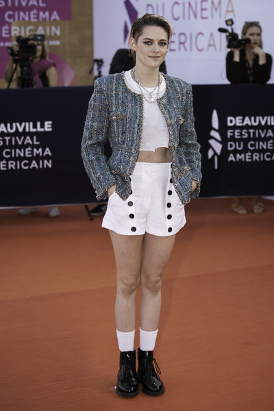 Kristen Stewart added a chic touch with a blue tweed jacket by Chanel.