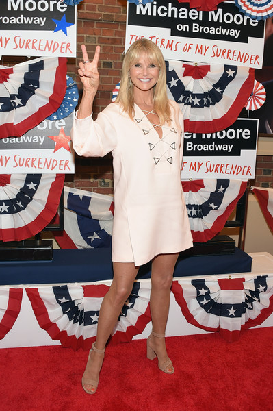 Christie Brinkley donned an ivory mini dress with a lace-up neckline for the Broadway opening of 'The Terms of My Surrender.'