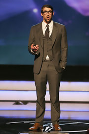 Michael Phelps opted for the geeky chic look with this brown three piece suit.