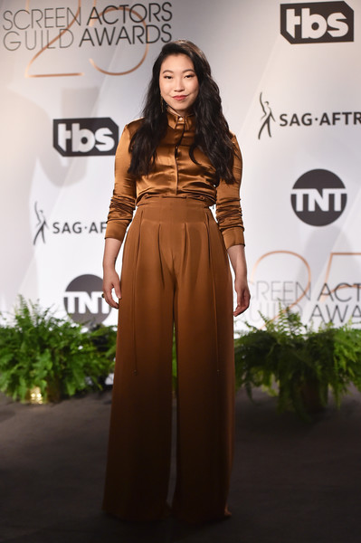 Awkwafina Wide Leg Pants [clothing,fashion,dress,carpet,brown,fashion model,hairstyle,yellow,fashion design,flooring,awkwafina,screen actors guild awards,west hollywood,california,pacific design center,nominations announcement]