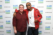 Elvis Duran's plain maroon button-down was low-key but still packed a lot of style.