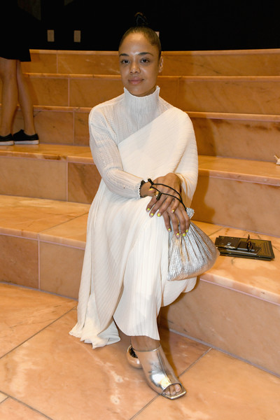 Tessa Thompson teamed gold open-toe mules with a white outfit for the No Commission party.