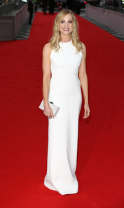 Joanne Froggatt's white Victoria Beckham column dress at the BAFTA celebration of 'Downton Abbey' featured an unadorned front and an open back with stone-embellished straps.