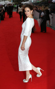 Lily James went for a playful finish with a pair of pompom-embellished peep-toes by Christian Louboutin.