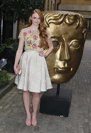 Sophie Turner chose a full brocade skirt for her chic but fun evening look at the BAFTA Craft Awards.