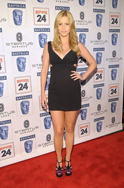 Claire Holt may have worn a basic LBD, but her frock had a slightly modern touch with the side cutouts.