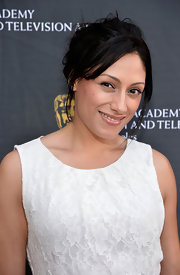 Tehmina Sunny's messy updo was an edgy contrast to her ladylike dress at the BAFTA LA garden party.