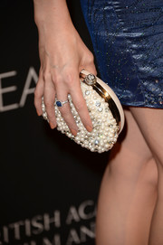 Victoria Summer accessorized with a luxurious pearl-encrusted clutch when she attended the BAFTA LA TV Tea.