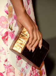 A metallic gold hard-case clutch added plenty of shimmer to Kerry Washington's look during the BAFTA LA TV Tea.