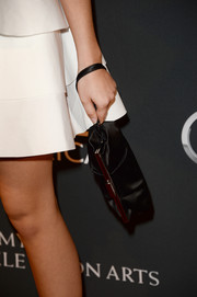 Sarah Hyland topped off her outfit with a vintage-chic satin wristlet when she attended the BAFTA LA TV Tea.