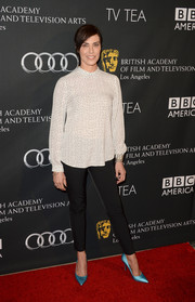 Michelle Forbes looked conservative in a long-sleeve pin-dot blouse and cigarette pants at the BAFTA LA TV Tea.