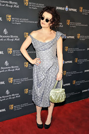 Helena Bonham Carter embraced polka dots with a chartreuse satin evening bag that matched the playful print of her off-the-shoulder dress.