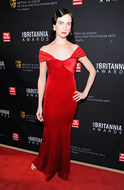 Victoria Summer was seasonal at the BAFTA Britannia Awards in a red velvet off-the-shoulder evening dress.