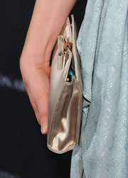 Alison Brie attended the BAFTA Los Angeles tea party carrying an adorable bow-adorned gold satin clutch.