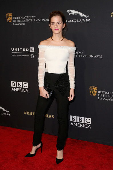 Emma Watson made a stylish appearance at the Britannia Awards in a white Balenciaga off-the-shoulder top featuring sheer long sleeves and embellishments along the neckline.
