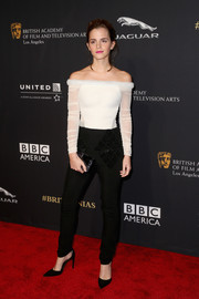Emma Watson paired her chic top with black Balenciaga skinny pants featuring diamond-shaped beadwork.
