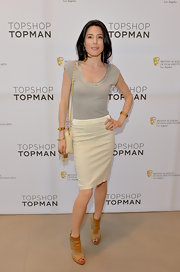 Jaime Murray kept her look simple and chic with a gray tee paired with a cream pencil skirt.
