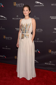 Marion Cotillard was effortlessly elegant at the BAFTA Los Angeles tea party in a Bottega Veneta evening dress with painterly embellishments on the bodice.