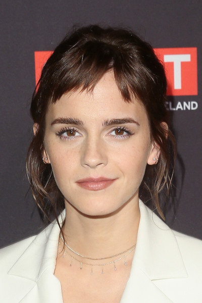 Emma Watson looked oh-so-cute wearing this messy half-up style with baby bangs at the BAFTA Los Angeles Tea Party.