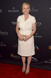 Patricia Arquette added a touch of sparkle via a pair of silver Alexandre Birman peep-toe pumps.