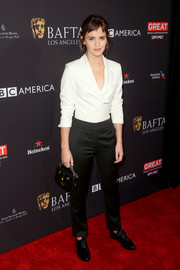 Emma Watson's beaded leather purse added a playful touch.