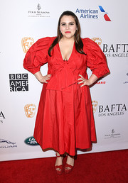 Beanie Feldstein matched her frock with red ankle-strap platforms by Giuseppe Zanotti.