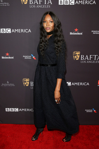 Naomi Campbell teamed her frock with black peep-toe booties.