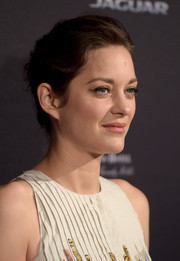 Marion Cotillard brushed her hair back into a loose bun for the BAFTA Los Angeles tea party.