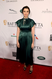 Rachel Weisz gave us vintage vibes with this emerald flutter-sleeve satin dress by Prada at the BAFTA Los Angeles Tea Party.