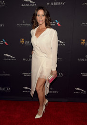 Amy Brenneman was boudoir-chic at the BAFTA Los Angeles tea party in a white wrap dress with lace slip showing.