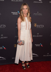 Cressida Bonas teamed her cute dress with black crisscross-strap platform sandals, also by Mulberry.